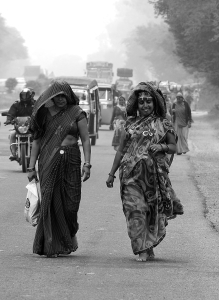 Devout walking barefoot on the highway